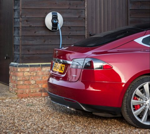Pod Point home charger installation charging a Tesla EV