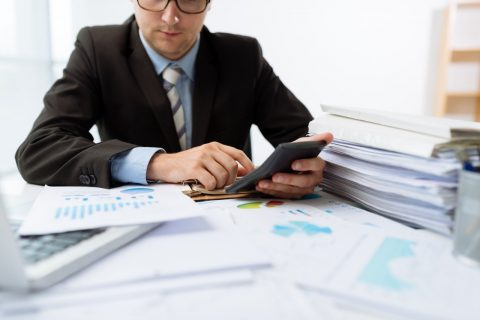 accountant studying whole life cost figures