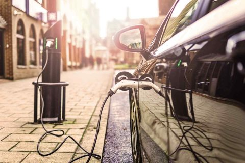 Electric car charging at a street charger